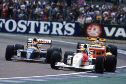 Foto Poster Ayrton Senna met Alain Prost tijdens de GP van Engeland 1993 in actie, F1 McLaren Team 1993
